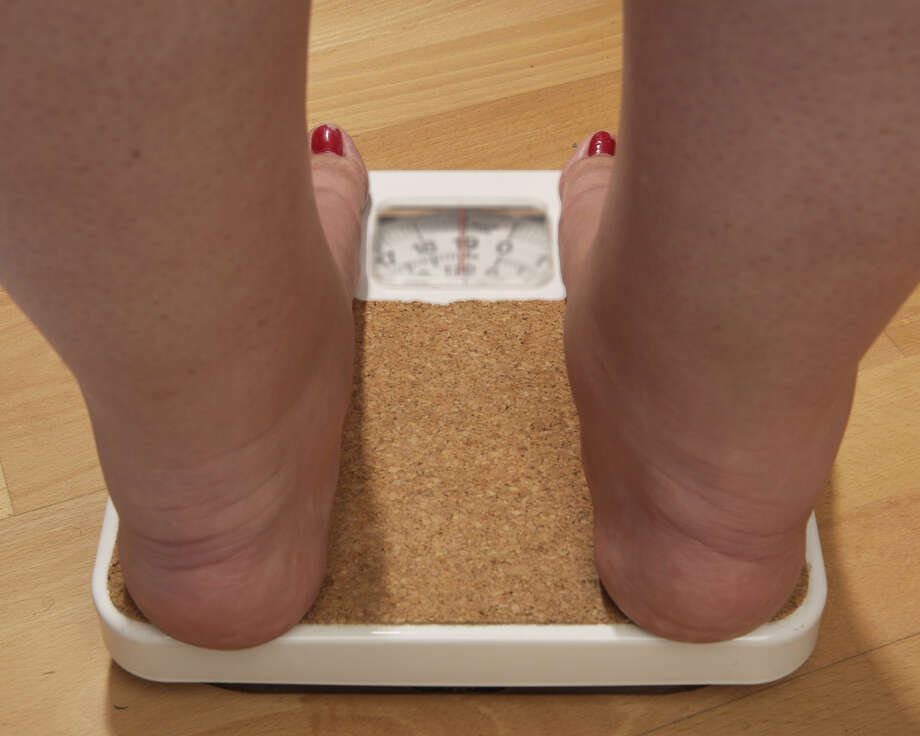 An anonymous woman, 42, on the scales before her weight loss surgery. Photo: Tina Stallard, Getty Images / 2006 Tina StallardGetty ImagesConnecticut Post contributedTina Stallard/Getty Images