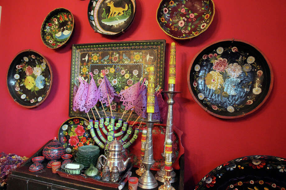 The dining room's red walls are the perfect backdrop for pieces from the collection of Mexican folk art that Margaret Schellenberg has been assembling since 1968. Photo: Tom Reel /San Antonio Express-News