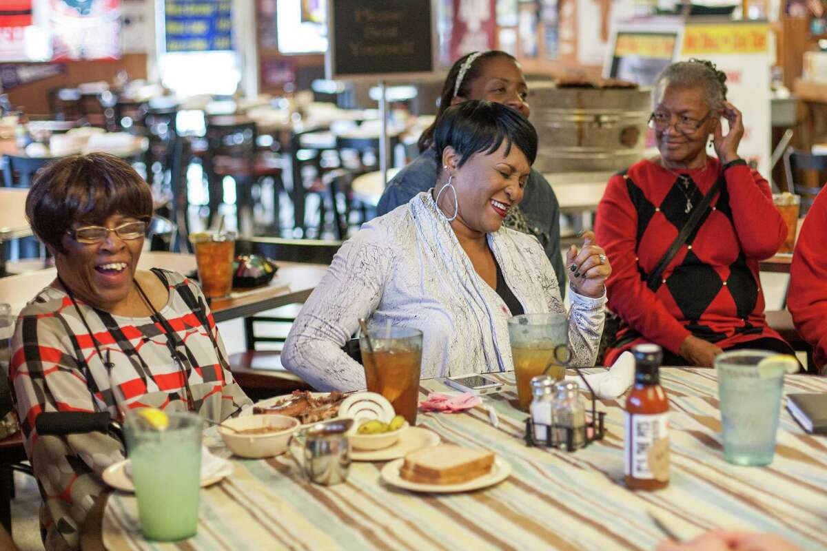 Lois Davis, from left, Lela Matthews, Priscilla Woods and Josephine Davis enjoy a lunch at Pizzitola'sBar-B-Cue. John and Lela Davis were the original owners of the restaurant formerly named Shepherd Drive Barbecue Stand.