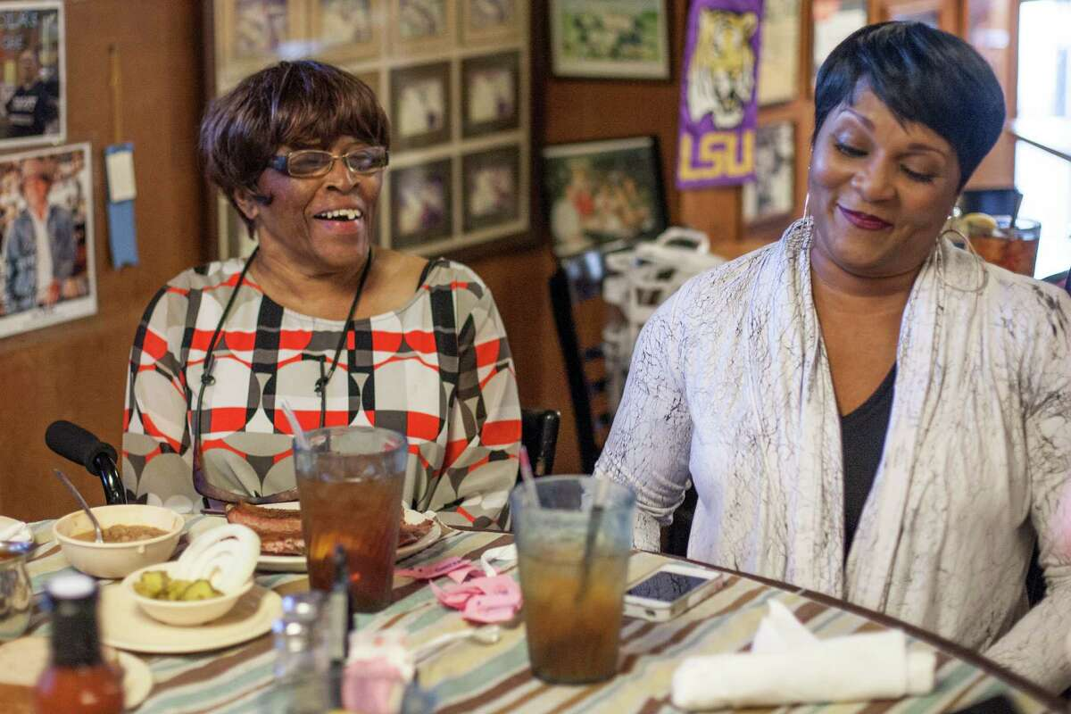 Lois Davis and Leila Matthews share a laugh during a lunch at Pizzitola's BBQ Wednesday December 10, 2014 in Houston, TX. Lois and Leila are the daughter and granddaughter of John and Leila Davis who were the original owners of the restaurant formerly named Shepherd Bar-B-Q. (Michael Starghill, Jr.)