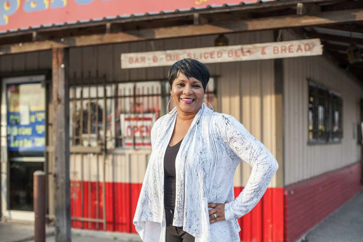 Leila Matthews poses for a picture in front of Pizzitola's BBQ Wednesday December 10, 2014 in Houston, TX. Matthews is the granddaughter of John and Leila Davis who used to own the restaurant which was formerly called Shephard Drive Bar-B-Q. (Michael Starghill, Jr.)
