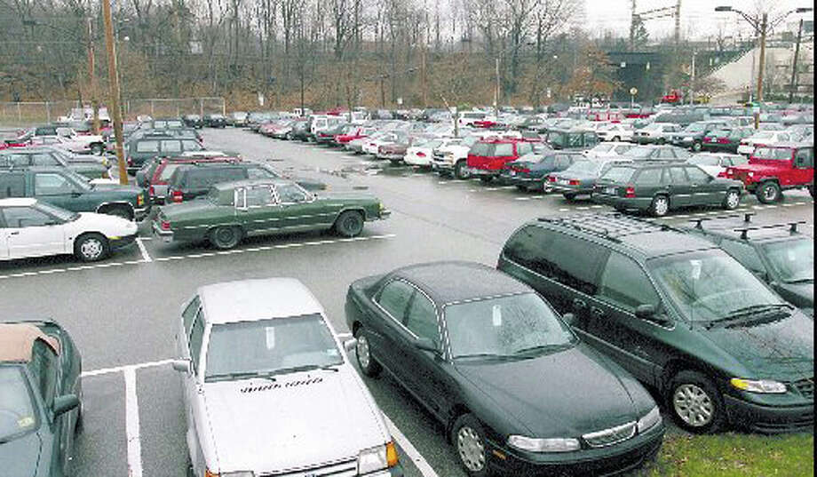 More commuters and others who park in Greenwich lots will soon be able to pay by phone. Photo: File Photo / Greenwich Time File Photo