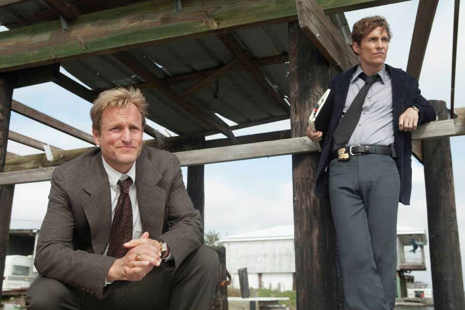 "This photo released by HBO shows Woody Harrelson, left, as Martin Hart, and Matthew McConaughey as Rustin Cohle, in a scene from HBO's TV series, ""True Detective,"" season 1. HBO says that Colin Farrell and Vince Vaughn will star in the second season of ""True Detective."" The eight-episode drama series will begin production in California this fall, the premium cable channel said Tuesday, Sept. 23, 2014. (AP Photo/HBO, Jim Bridges) ORG XMIT: CAET813 Photo: JIm Bridges / HBO"