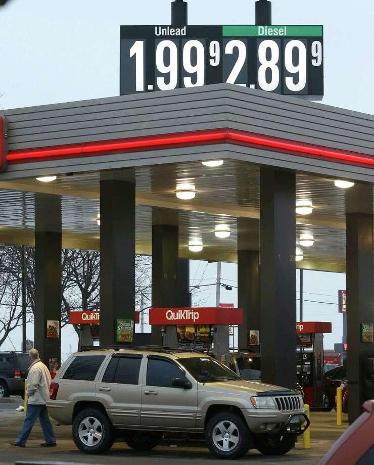 A motorist fills his tank at a convenience store in Platt City, Missouri, where prices dipped below $2 a gallon. Photo: Orlin Wagner /Associated Press / AP