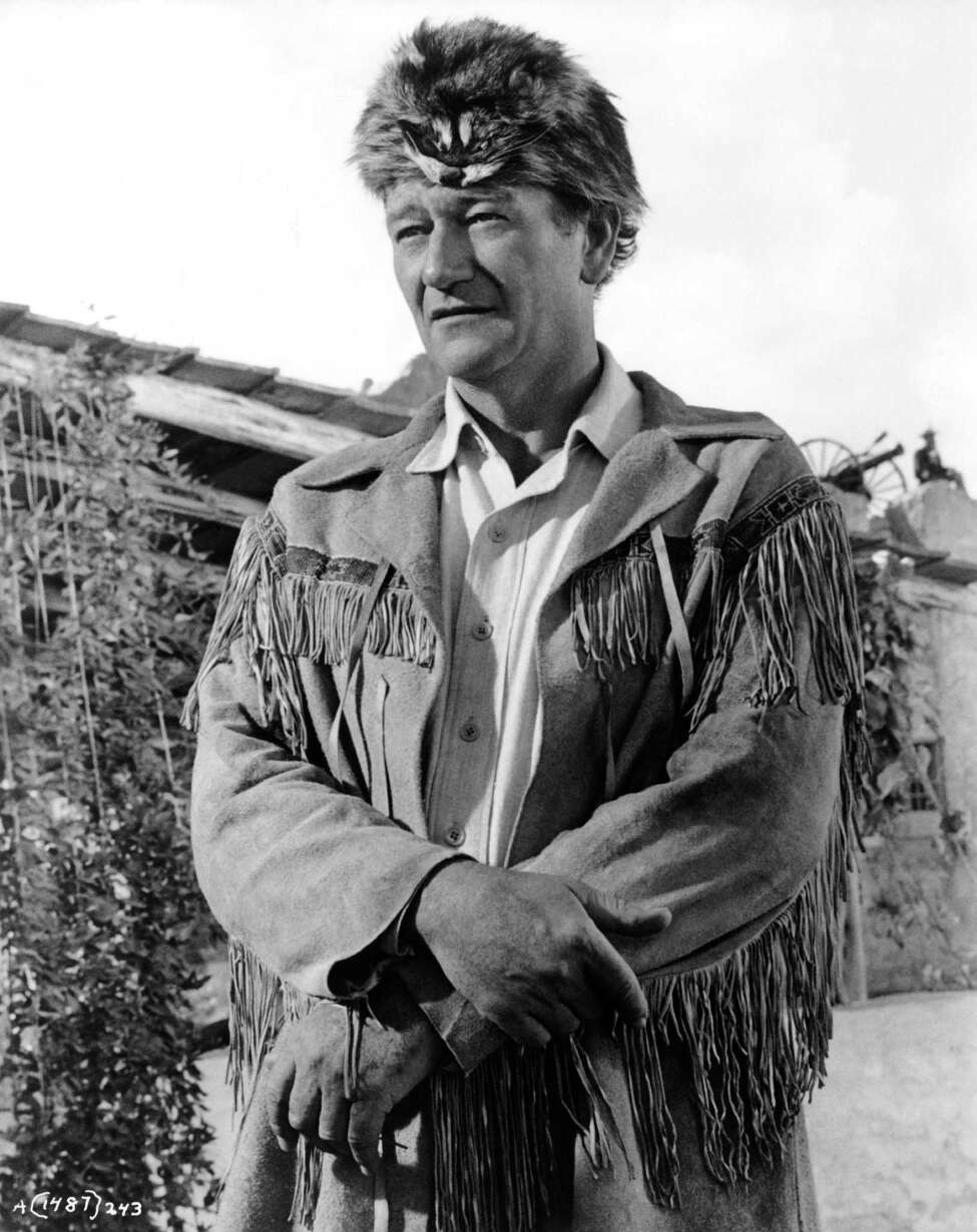 John Wayne is photographed on the set of his movie