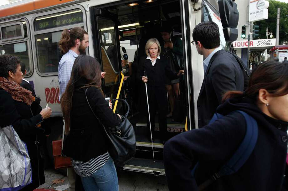 "Kate Williams, 72, exits a bus on her way to work as the Employment Immersion Manager at the LightHouse for the Blind and Visually Impaired Dec. 8, 2014 in San Francisco, Calif. Williams joined LightHouse for the Blind and Visually Impaired in 2011 and she began building an employment program. ""It's been the greatest job I've ever had,"" Williams said. Photo: Leah Millis / The Chronicle / ONLINE_YES"
