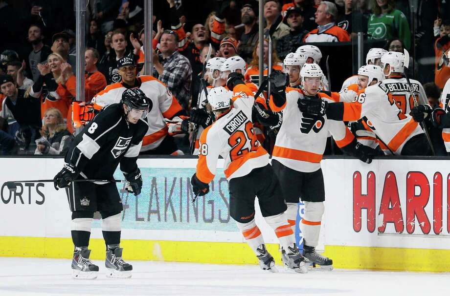 Kings defenseman Drew Doughty (left) could be down after a Flyers goal this month or he could simply be exhausted. He's the only NHL skater this season with 1,000 minutes of ice time. Photo: Danny Moloshok / Associated Press / FR161655 AP