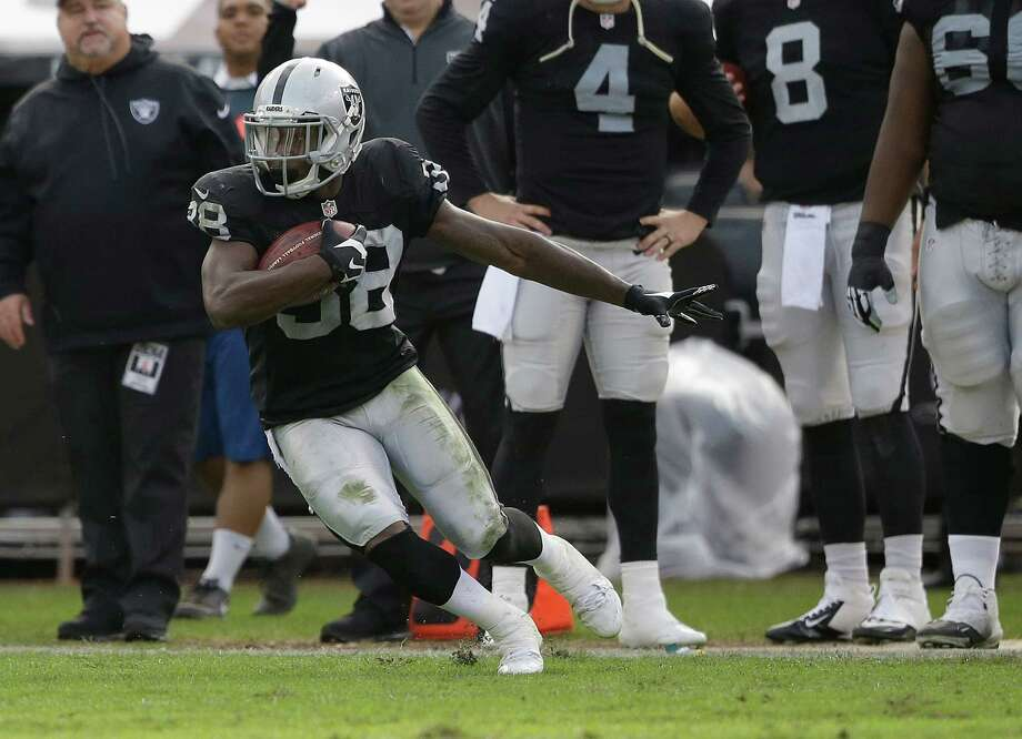 Besides his cornerback duties, TJ Carrie also returned three punts against Buffalo on Sunday. Photo: Marcio Jose Sanchez / Associated Press / AP