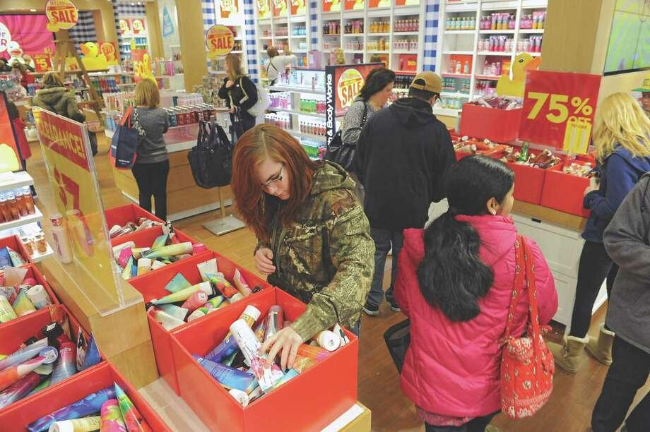 Shoppers look for sales at Bath and Body Works at Crossgates Mall on Friday, Dec. 26, 2014 in Guilderland, N.Y. (Lori Van Buren / Times Union) Photo: Lori Van Buren / 00029999A
