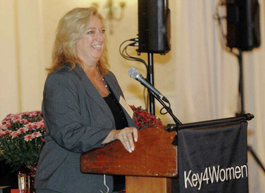 Nathalie Whitton, president and CEO of Site Solutions Worldwide, accepts the Key4Women Achieve Award at the Key4Women event at Wolfert's Roost Country Club on Wednesday, Oct. 8, 2014, in Albany, N.Y.  (Paul Buckowski / Times Union) Photo: Paul Buckowski / 10028921A