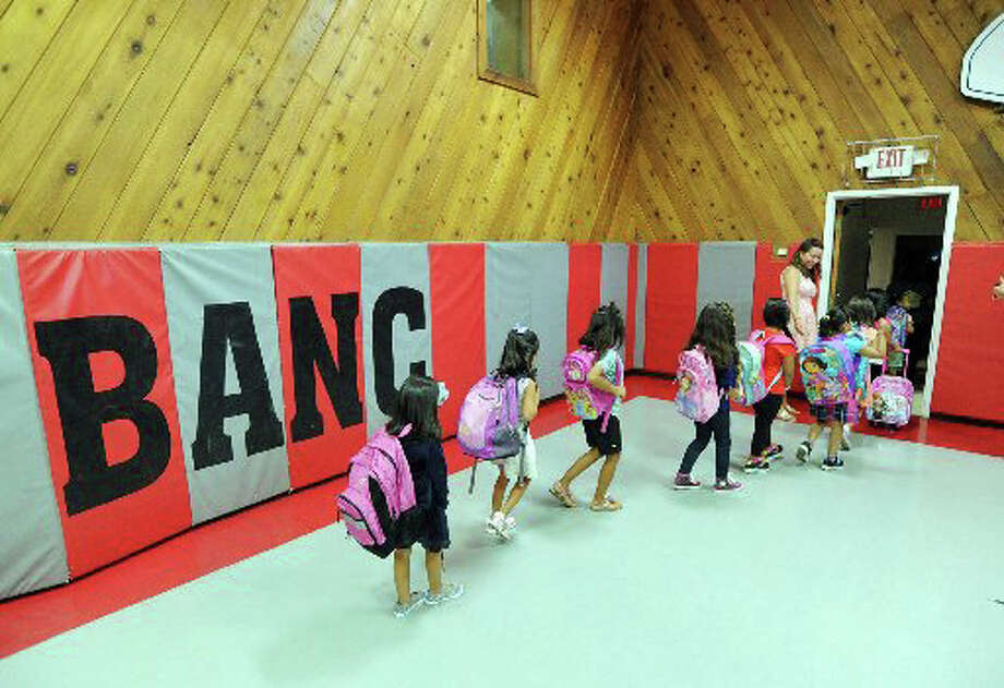 New Lebanon School kindergarten students file out of the Byram Archibald Neighborhood Center in September. Photo: File Photo / Greenwich Time File Photo