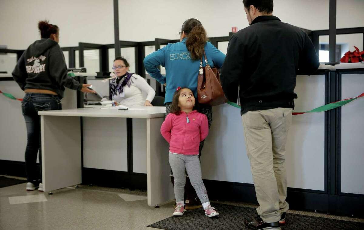 Diana Chacon waits for his parents, Marabel Nam bo and Juan Chacon, at San Jose's DMV.