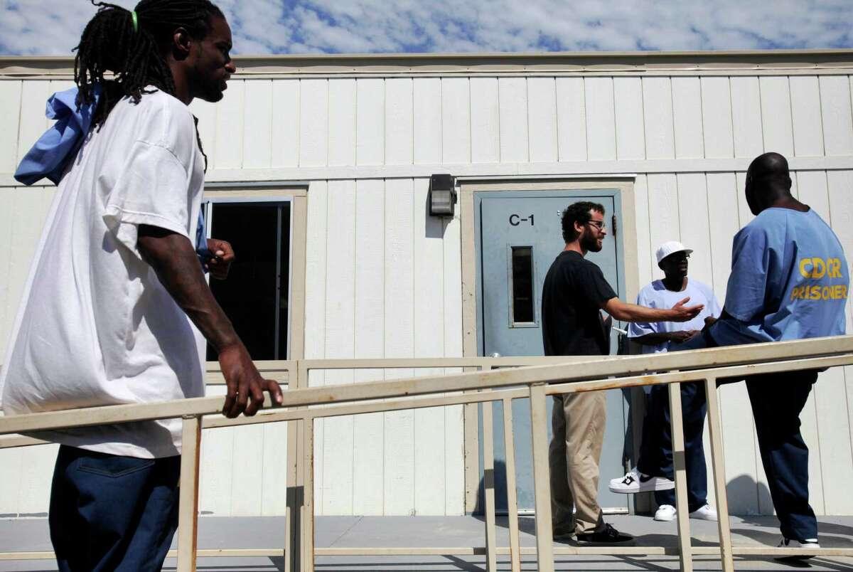 Timothy Nash, 35 (left), UC Berkeley graduate student Jake Martin Grumbach, 26, Kinte Hogan, 37, and Cleo Cloman, 37, take a break during U.S. history class at San Quentin State Prison.