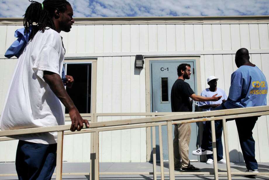 Timothy Nash, 35 (left), UC Berkeley graduate student Jake Martin Grumbach, 26, Kinte Hogan, 37, and Cleo Cloman, 37, take a break during U.S. history class at San Quentin State Prison. Photo: Leah Millis / The Chronicle / ONLINE_YES