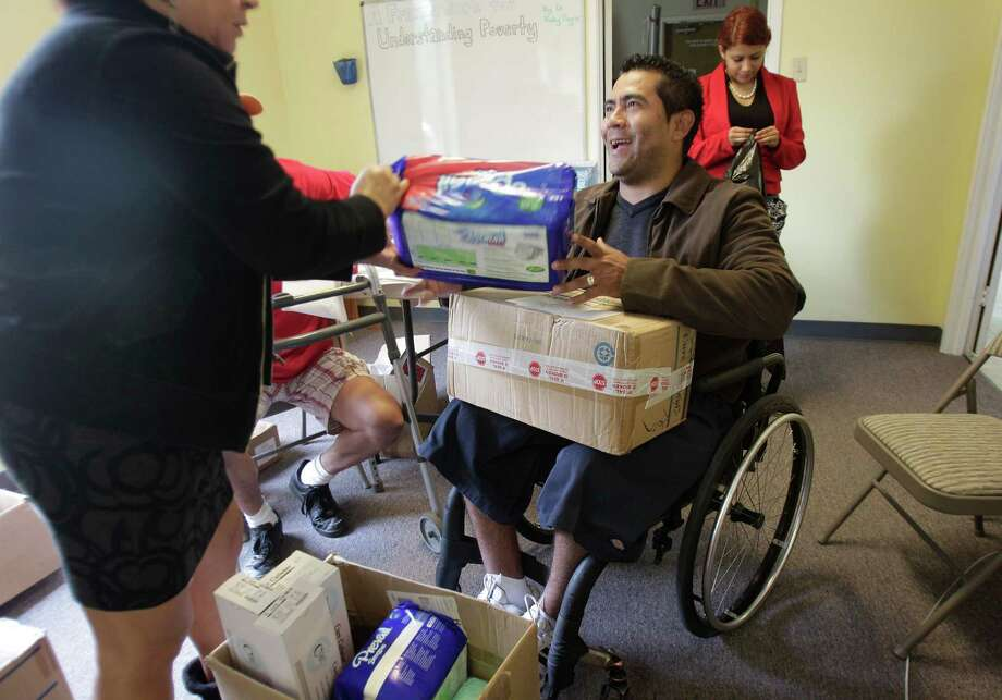 Edwin Hernandez is among the beneficiaries of the Living Hope Wheelchair Association's medical supply distributions. Photo: Mayra Beltran, Staff / © 2014 Houston Chronicle