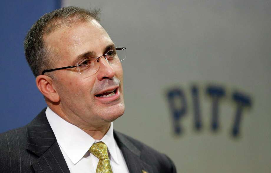 Pat Narduzzi, the former longtime Michigan State defensive coordinator, speaks at a news conference in Pittsburgh where he was introduced as the new head football coach at the University of Pittsburgh, Friday, Dec. 26, 2014. Narduzzi replaces Paul Chryst, who left Pitt last week after three seasons to become the coach at Wisconsin.(AP Photo/Keith Srakocic) ORG XMIT: PAKS103 Photo: Keith Srakocic / AP