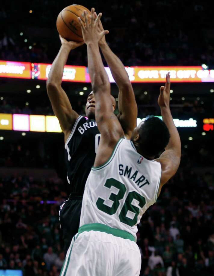 Brooklyn Nets' Jarrett Jack (0) shoots a tiebreaking jump shot in the lane over Boston Celtics' Marcus Smart (36) with seconds to play in the fourth quarter of an NBA basketball game in Boston, Friday, Dec. 26, 2014. The Nets won 109-107. (AP Photo/Michael Dwyer) ORG XMIT: MAMD113 Photo: Michael Dwyer / AP