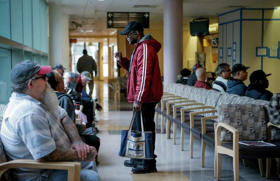 Outreach coordinator for veterans Felton Mackey visits the lobby of the Veterans Affairs Medical Center, to talk with veterans about Shelter Inc. and the services they provide to veterans, in Martinez, Calif. on Friday Dec. 5, 2014. Photo: Michael Macor / The Chronicle / ONLINE_YES