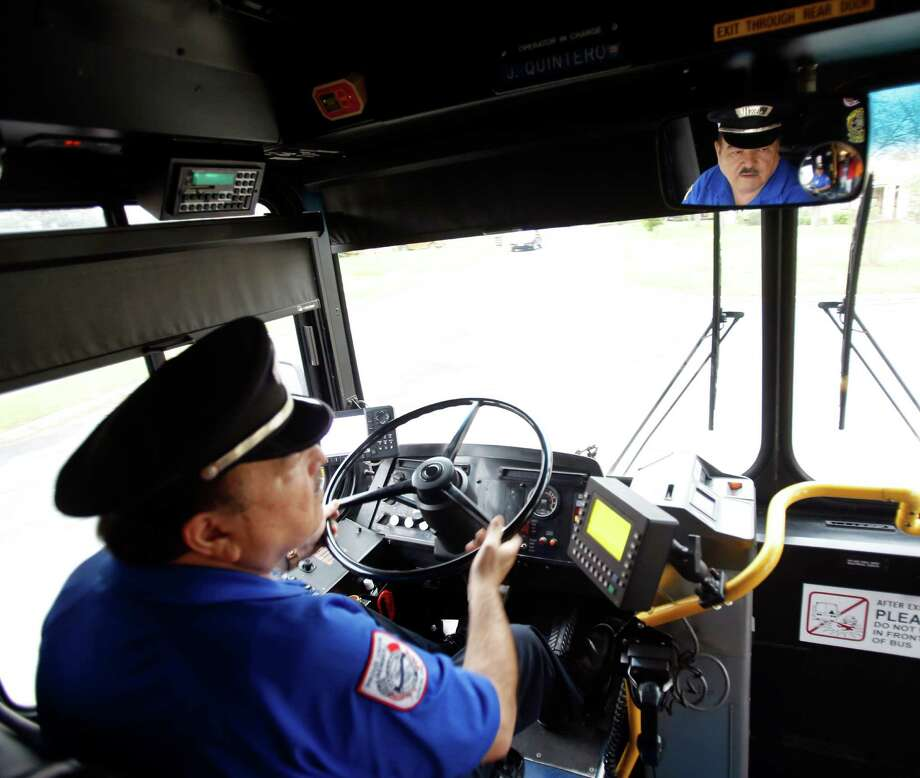 Jesse Quintero, who has been driving a bus for San Antonio public transit since the 1960s, is one of only a handful of drivers nationwide who have driven 3 million miles without an accident. He is about 80,000 miles from crossing the 4-million-mile mark, which he might reach by the end of 2015. Photo: William Luther / © 2014 San Antonio Express-News