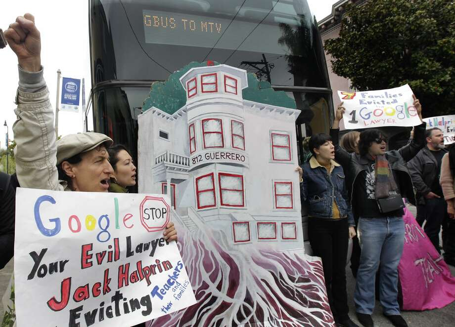 Tommi Avicolli Mecca (left) and other protesters, angered by the high number of Ellis Act evictions on tenants, prevent a Google bus from leaving 18th and Dolores streets in San Francisco, Calif. on Friday, April 11, 2014. Photo: Paul Chinn, The Chronicle