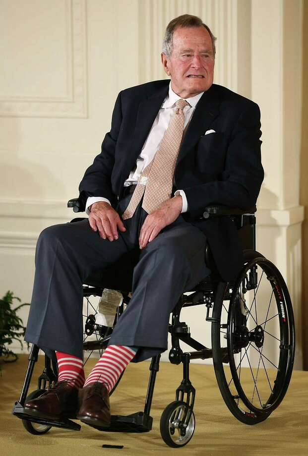FILE - DECEMBER 24, 2014: It was reported that former U.S. President George H.W. Bush was hospitalized after experiencing a shortness of breath December 24, 2014 in Houston, Texas. WASHINGTON, DC - JULY 15:  Former President George H. W. Bush wears red stripped socks as he sits in a wheelchair during an event in the East Room at the White House, July 15, 2013 in Washington, DC. Bush joined President Obama in hosting the event to honor the 5,000th Daily Point of Light Award winner.  (Photo by Mark Wilson/Getty Images) Photo: Mark Wilson,  Staff / Getty Images / 2013 Getty Images