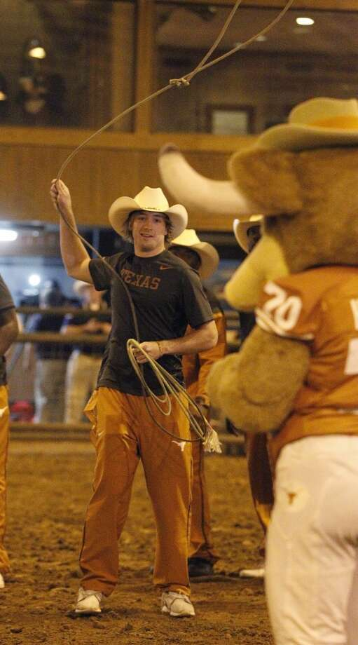 University of Texas' Nick Rose tries to rope Bevo the mascot during the Texas Bowl Rodeo at the George Historical Ranch, Friday, Dec. 26, 2014, in Richmond. ( Karen Warren / Houston Chronicle  ) Photo: Houston Chronicle