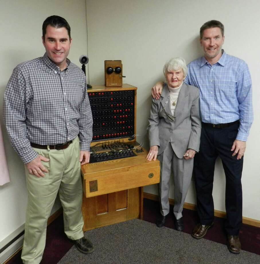 In this Dec. 18, 2014 photo, Marjorie Becker, is flanked by her two grandsons, Jason, left, and Jim Becker, in Middleburgh, N.Y. At the age of 92, Becker still looks forward to going to work each day at her company, the Middleburgh Telephone Co. (AP Photo/Oneonta Daily Star, Joe Mahoney) ORG XMIT: NYONE501 Photo: Joe Mahoney / Oneonta Daily Star