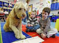 Miss Sigmund enjoys her time with students Sean Larson, left and Gabriel Fasciglione during reading period at the Pine Bush Elementary School,Thursday morning Dec. 11, 2014 in Schenectady, N.Y.     (Skip Dickstein/Times Union)