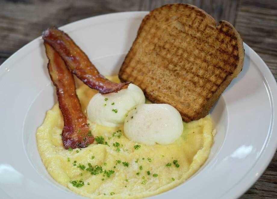 Coddled eggs on soft polenta Photo: Express-News File Photo / San Antonio Express-News
