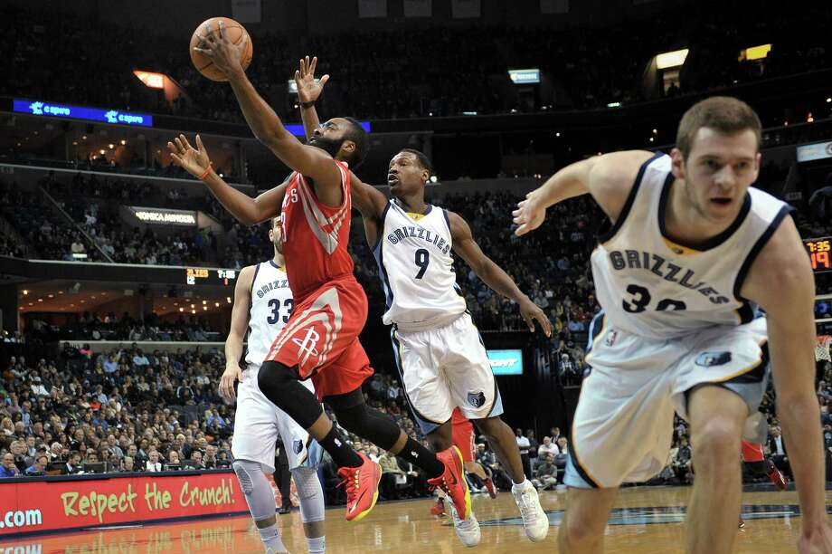 Houston Rockets guard James Harden (13) shoots past Memphis Grizzlies guard Tony Allen (9), center Marc Gasol (33) and forward Jon Leuer (30) during the first half of an NBA basketball game Friday, Dec. 26, 2014, in Memphis, Tenn. (AP Photo/Brandon Dill) ORG XMIT: TNBD104 Photo: Brandon Dill / FR171250 AP