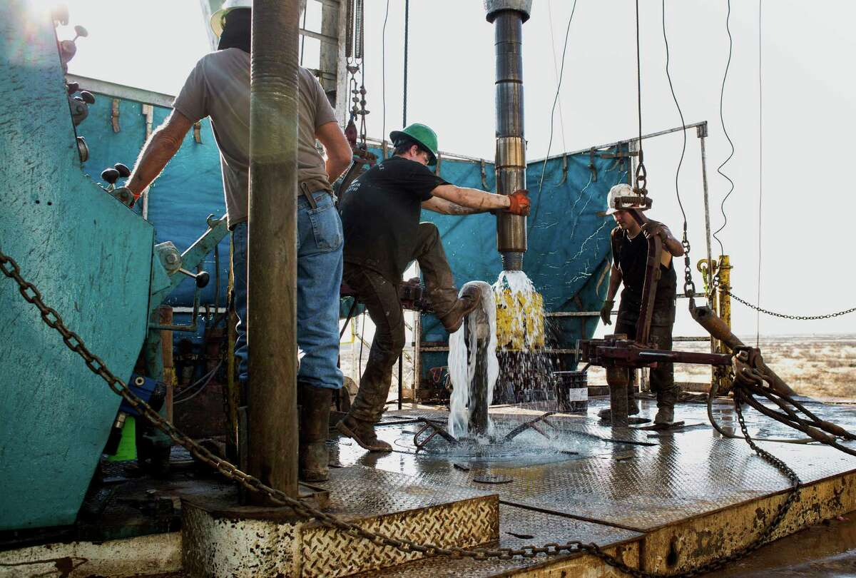 Drilling activity that kept workers busy just a few months ago is slowing down, and OPEC predicted Monday that the U.S. energy boom will stall. (Brittany Sowacke/Bloomberg)