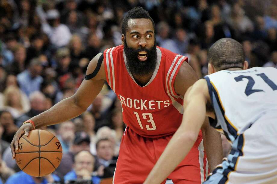 Houston Rockets guard James Harden controls the ball against Memphis Grizzlies forward Tayshaun Prince (21) during the first half of an NBA basketball game Friday, Dec. 26, 2014, in Memphis, Tenn. (AP Photo/Brandon Dill) Photo: Brandon Dill / Associated Press / FR171250 AP