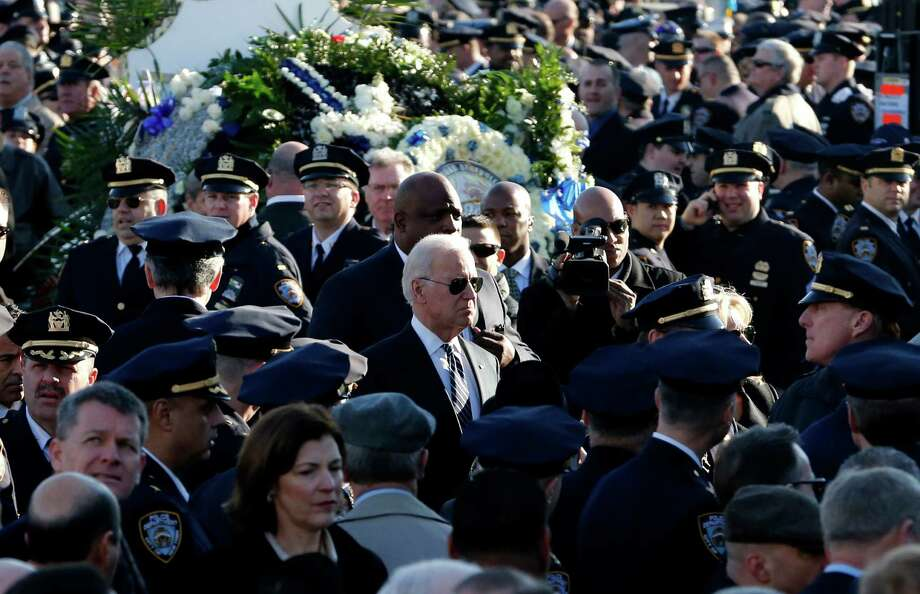 U.S. Vice President Joe Biden, center, arrives for funeral services for New York City police officer Rafael Ramos at Christ Tabernacle Church, in the Glendale section of Queens, Saturday, Dec. 27, 2014, in New York. Ramos and his partner, officer Wenjian Liu, were killed Dec. 20 as they sat in their patrol car on a Brooklyn street. The shooter, Ismaaiyl Brinsley, later killed himself. (AP Photo/Julio Cortez) ORG XMIT: NYJC111 Photo: Julio Cortez / AP