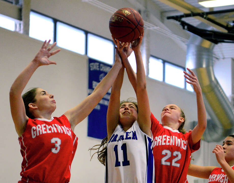 Darien's Katie Richter, center, tries to grab a Greenwich rebound as Greenwich's Emily Hunt, left, and Emma Baker converge, during Tony LaVista Basketball Tournament action in Darien, Conn. on Saturday Dec. 28, 2014. Photo: Christian Abraham / Connecticut Post