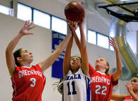 Darien's Katie Richter, center, tries to grab a Greenwich rebound as Greenwich's Emily Hunt, left, and Emma Baker converge, during Tony LaVista Basketball Tournament action in Darien, Conn. on Saturday Dec. 28, 2014.