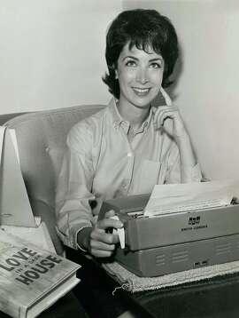 "Merla Zellerbach in 1962 with her book ""Love in a Dark House"" / Courtesy Merla Zellerbach"