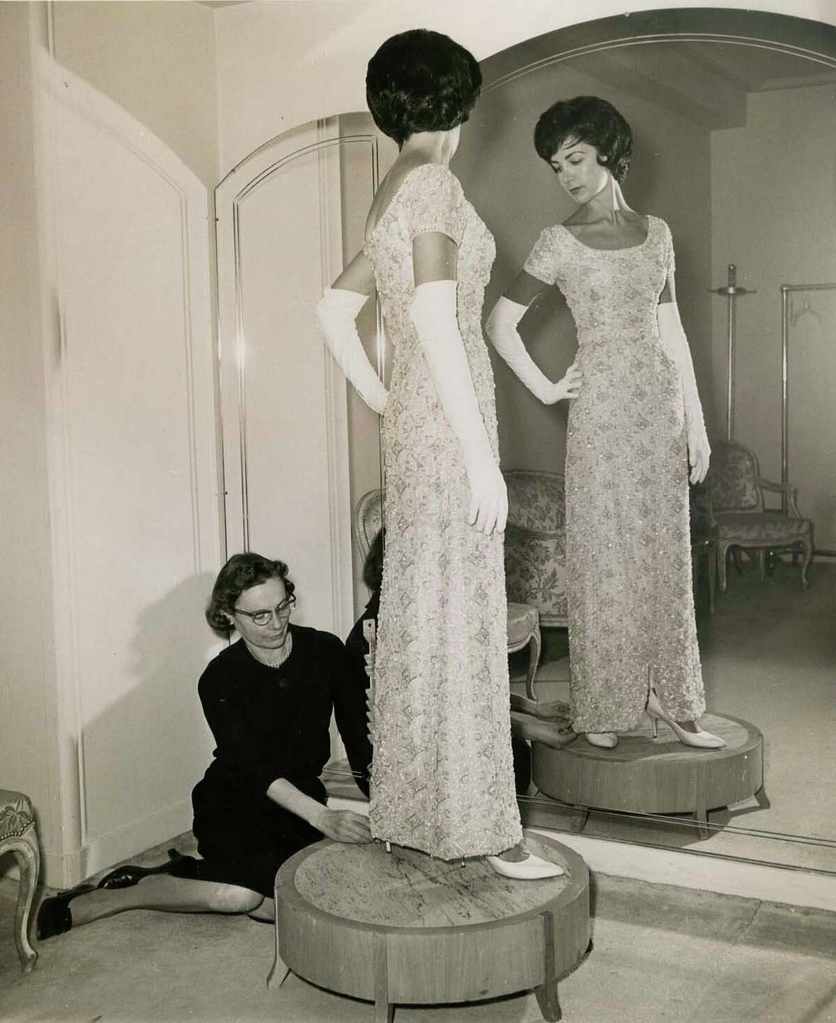 Merla Zellerbach gets fitted in a dress for the San Francisco Opera opening around 1960. The noted civic leader died Dec. 26 of pancreatic cancer.