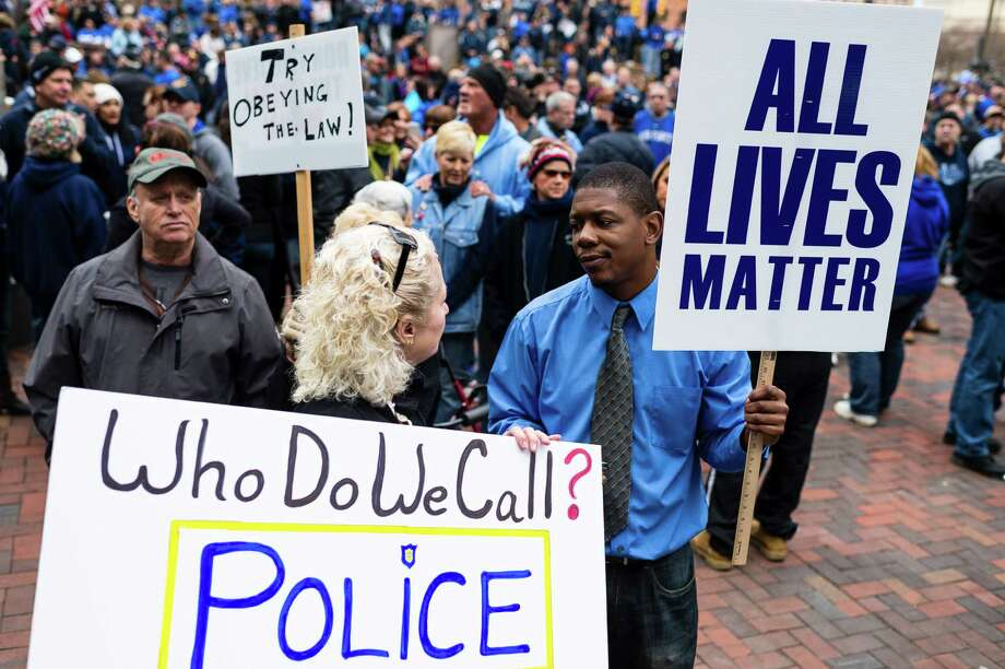 CLEVELAND, OH- DECEMBER 27: Pro-police supporters Debbie Darling (L) and Demetrius Brown (R) have a conversation during a rally in Public Square December 27, 2014, in Cleveland, Ohio. Demonstrators gathered to show support for police officers before marching to The Greater Cleveland Peace Officers Memorial. Photo: Angelo Merendino, Getty Images / 2014 Getty Images