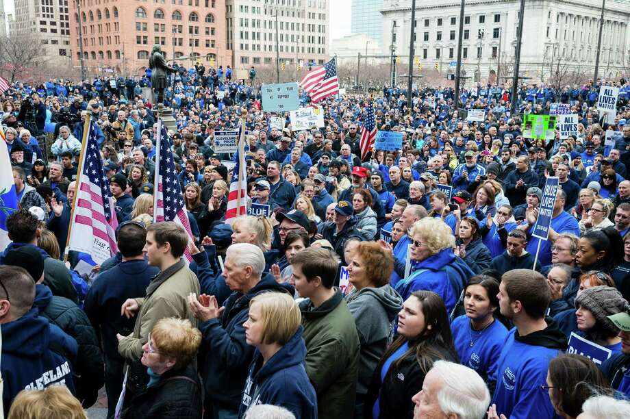 CLEVELAND, OH- DECEMBER 27:  Demonstrators bow their head for a moment of silence during a pro-police rally December 27, 2014, in Cleveland, Ohio. Demonstrators gathered in Public Square to show support for police officers before marching to The Greater Cleveland Peace Officers Memorial. Photo: Angelo Merendino, Getty Images / 2014 Getty Images