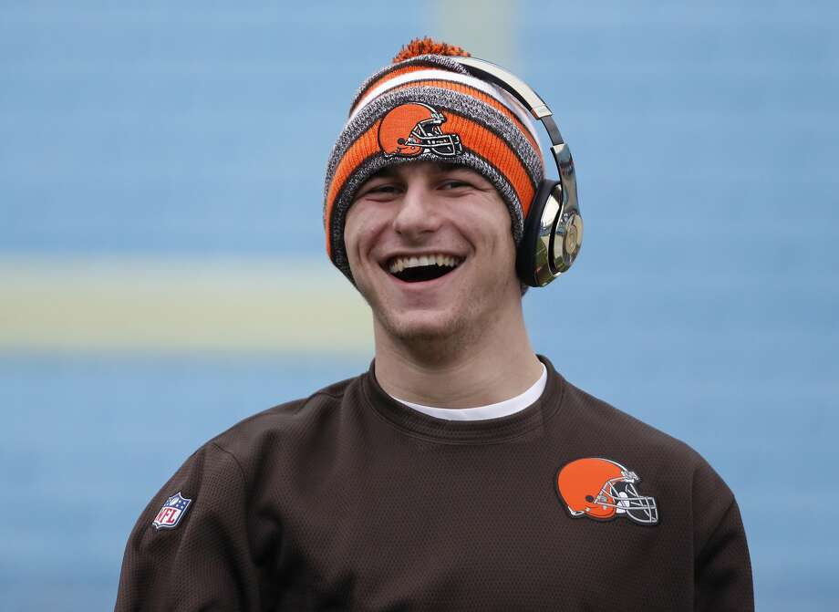 Cleveland Browns quarterback Johnny Manziel smiles as he warms up before an NFL football game against the Carolina Panthers in Charlotte, N.C., Sunday, Dec. 21, 2014. (AP Photo/Bob Leverone) Photo: Bob Leverone, Associated Press