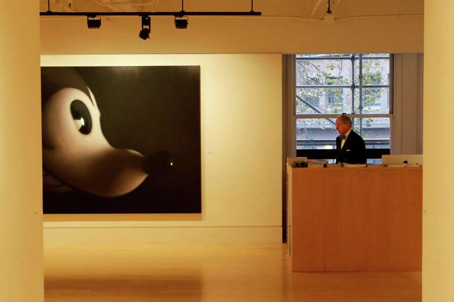 "Swiss-born art lover Martin Muller goes face to face with ""Gray Mouse 7,"" by Gottfried Helnwein, in his gallery Modernism, which is celebrating its 35th anniversary in San Francisco this year. Photo: Terray Sylvester / The Chronicle / ONLINE_YES"