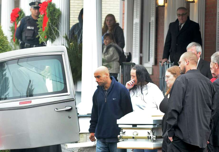 Five-year -old Kenneth White's casket is carried out of the Riley Mortuary  following calling hours on Saturday Dec. 23, 2014 in Amsterdam, N.Y. (Michael P. Farrell/Times Union) Photo: Michael P. Farrell / 00029992A