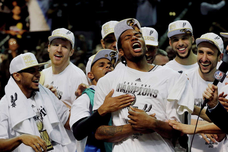 Most Valuable Player San Antonio Spurs forward Kawhi Leonard, third from right, celebrates after Game 5 of the NBA Finals against the Miami Heat on June 15, 2014, in San Antonio. The Spurs won the NBA championship 104-87. Photo: David J. Phillip /Associated Press / AP2014