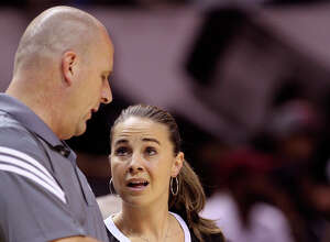 Former Spurs assistant coach Jim Boylen talks with Becky Hammon during an open scrimmage at the AT&T Center on Oct. 1, 2014.