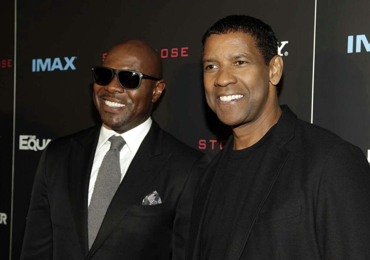 """Antoine Fuqua, left, and Denzel Washington, attend a screening of """"The Equalizer"""" on Monday, Sept. 22, 2014 in New York. (Photo by Andy Kropa/Invision/AP) ORG XMIT: NYAK107"""