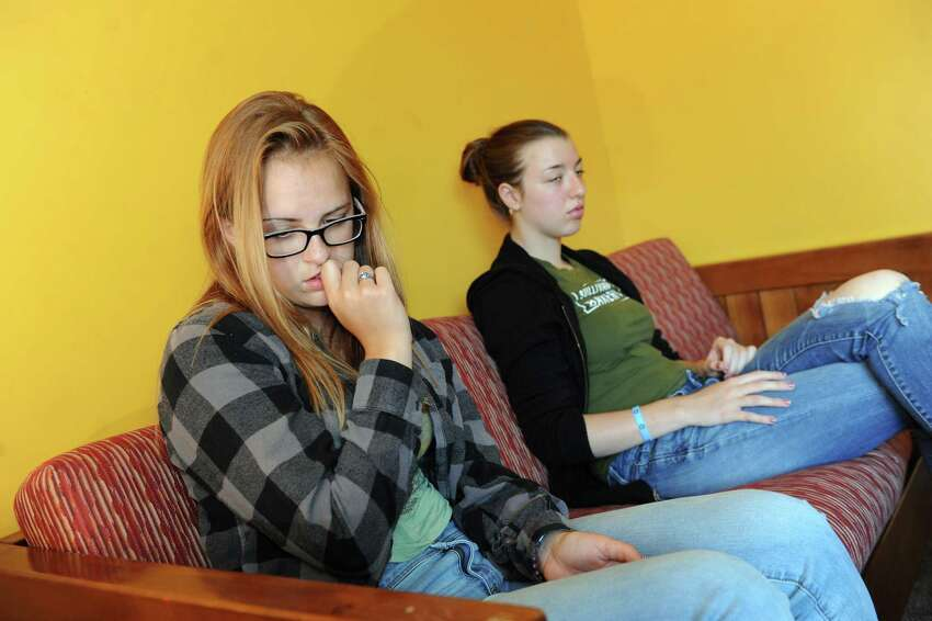 Clients Naomi, 16, left, and Gwyn, 16, who are both in recovery for heroin addiction, share their stories on Tuesday, Aug. 19, 2014, at Hope House in Albany, N.Y. (Cindy Schultz / Times Union) ORG XMIT: MER2014082221590358
