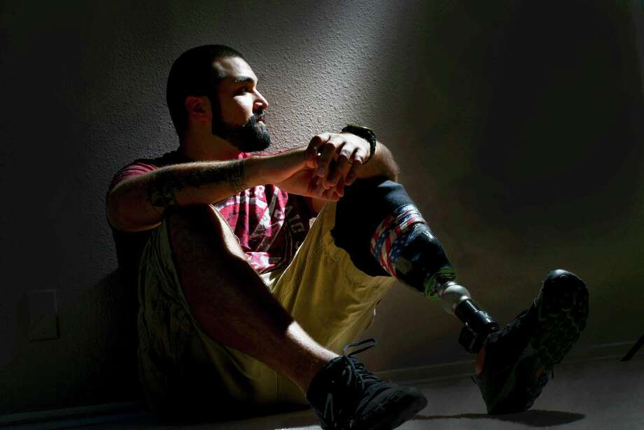 "Derrick Ross relaxes in his new San Antonio home on Friday, Oct. 31, 2014. Ross' nickname is ""Rage."" He was photographed on Oct. 30, 2014. Photo: Billy Calzada, By Billy Calzada/Express News / San Antonio Express-News"