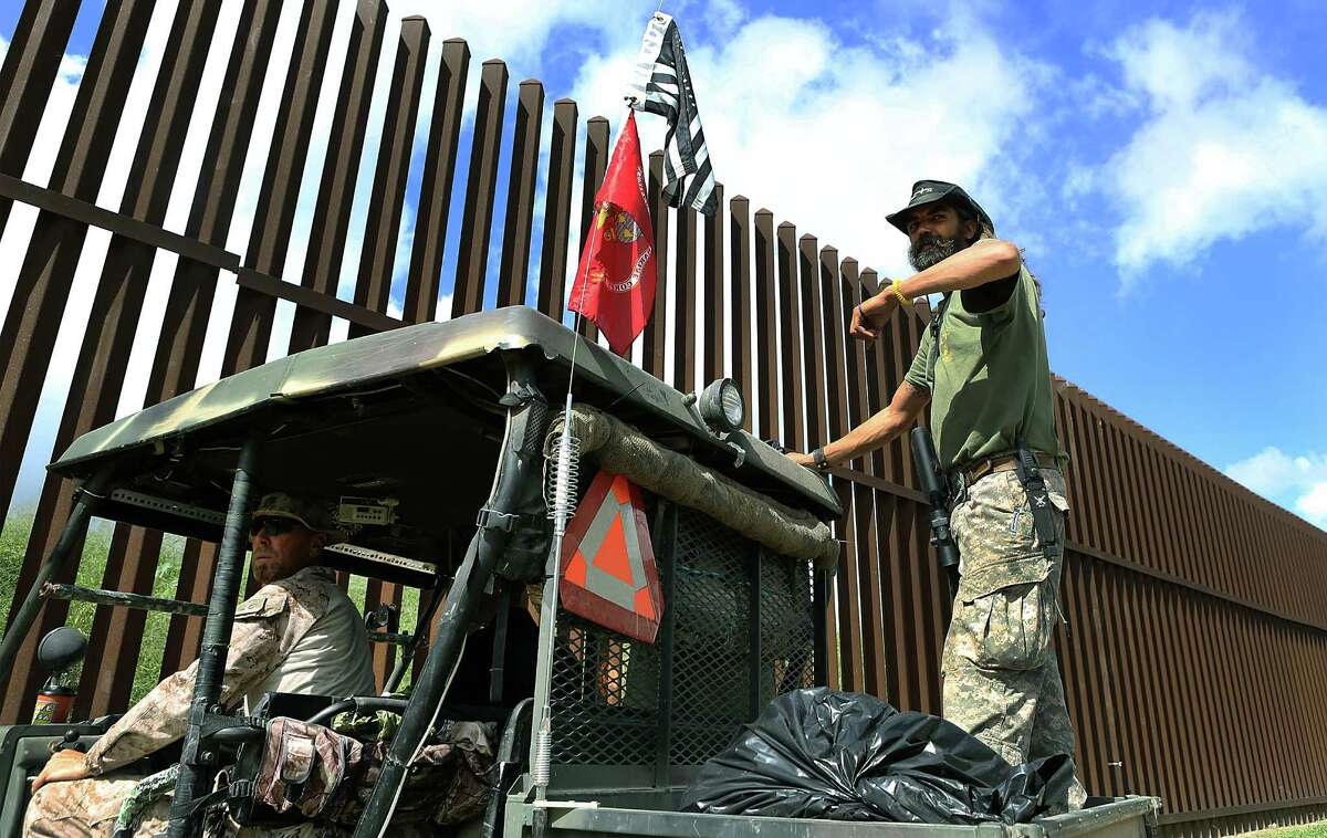 KC Massey, left, and John Forester patrol the border wall along the Rio Grande River in Brownsville, TX, on property owned by Rusty Monsees. Wednesday, September 10, 2014