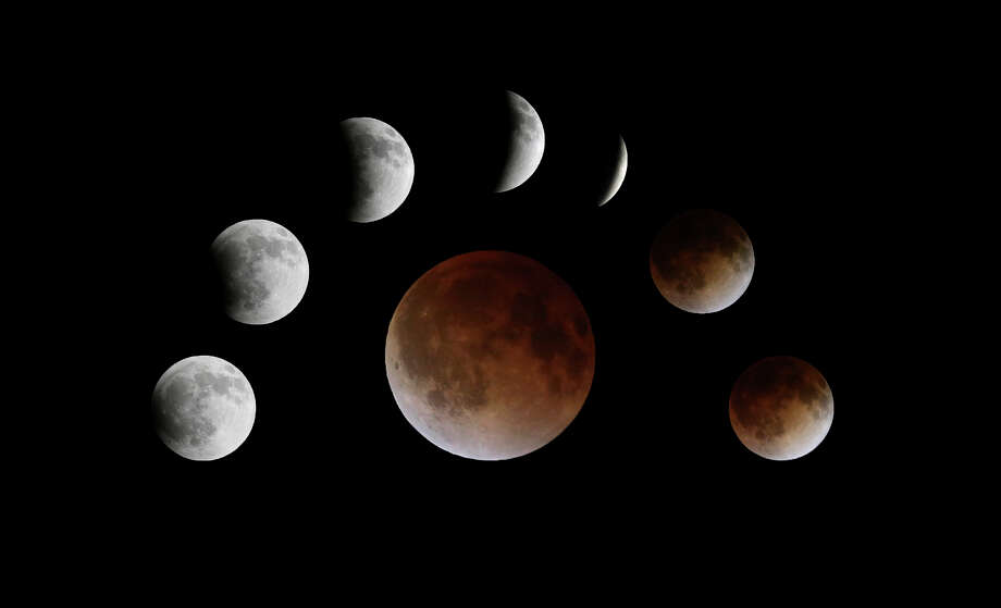 "A composite photograph view of the total lunar eclipse ""blood moon"" Tuesday April 15, 2014. Photo: Edward A. Ornelas, By Edward A. Ornelas, Express-News / © 2014 San Antonio Express-News"
