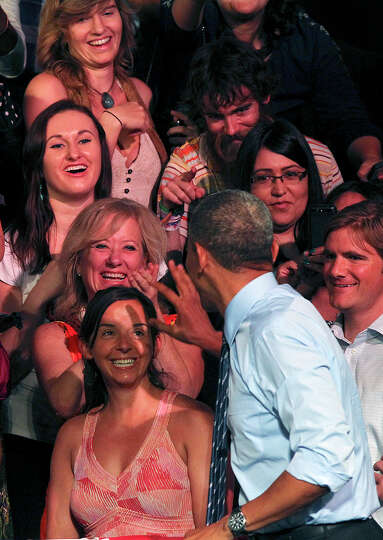 President Barack Obama greets supporters after delivering his remarks at the Paramount Theatre in Au